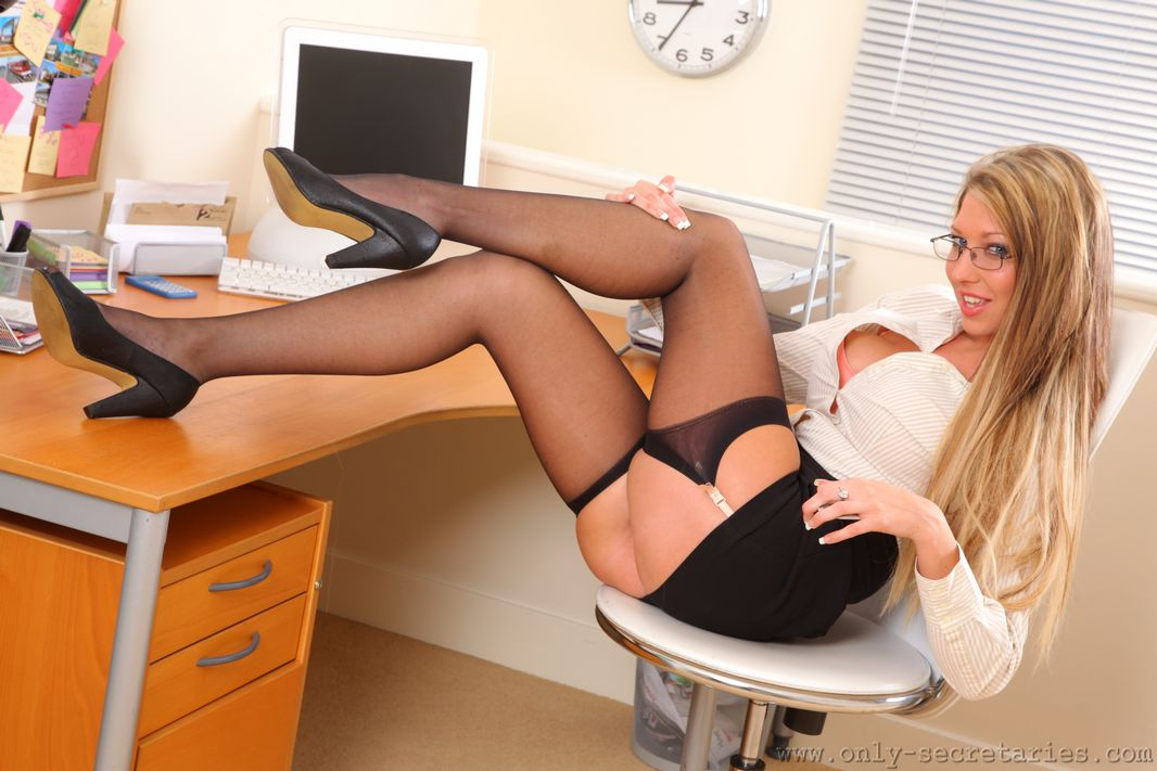 Lexi Lowe at the office in a miniskirt and stockings